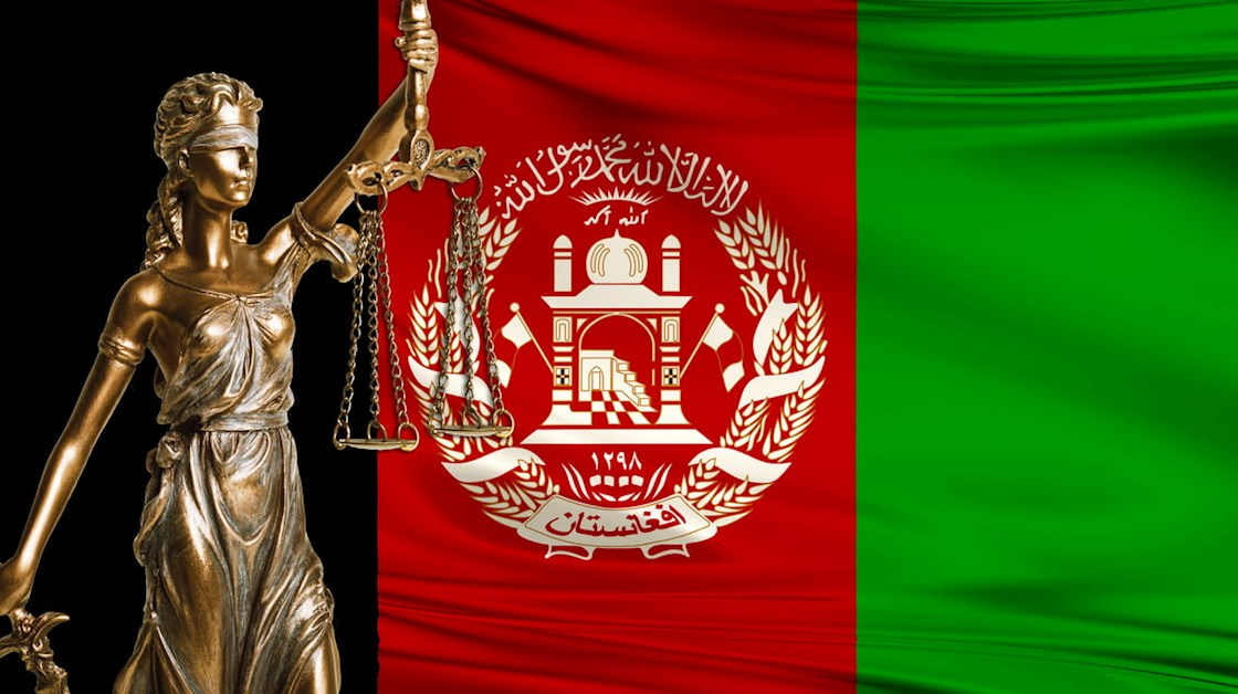 lady-justice-in-front-of-afghan-flag
