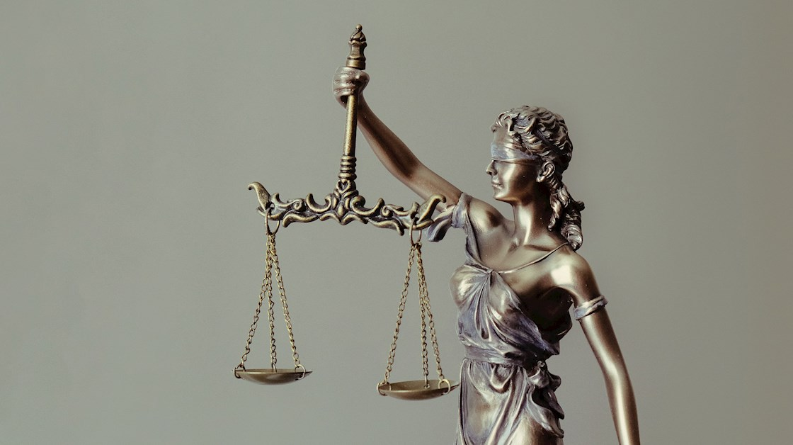 Lady justice holding scales and wearing blindfold