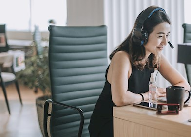 Woman taking phone call in socially distanced office