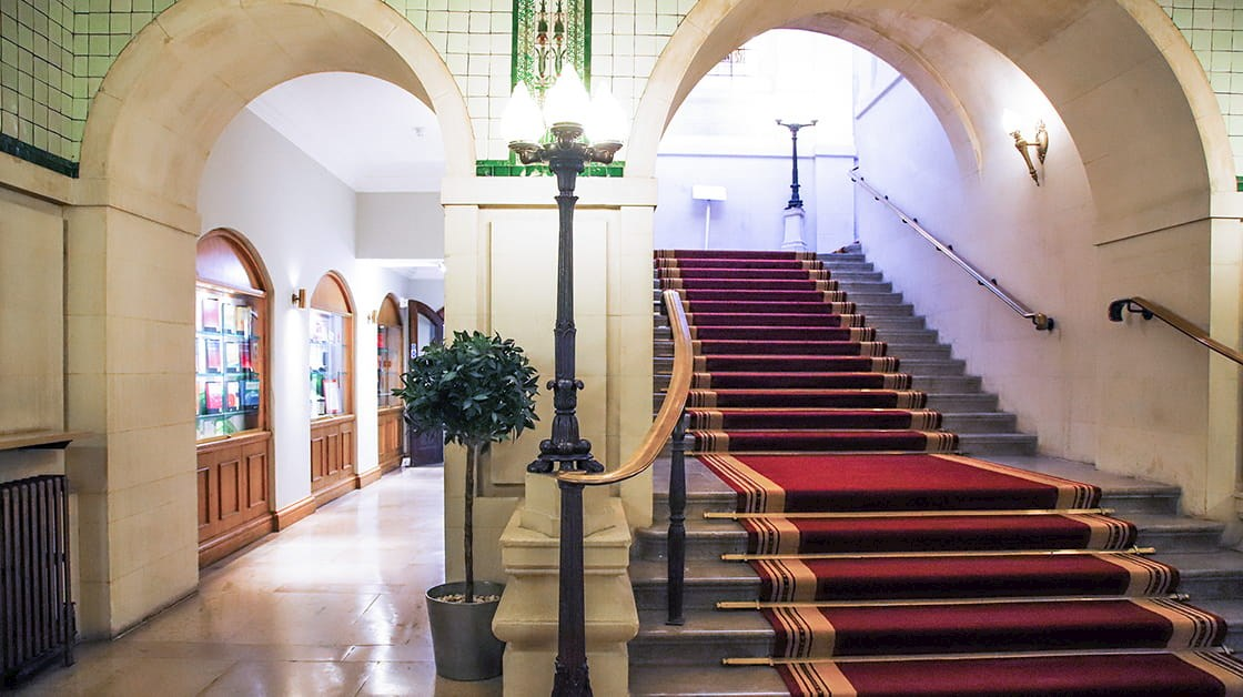 Stairs with red carpet leading to Law Society common room in 113 Chancery Lane