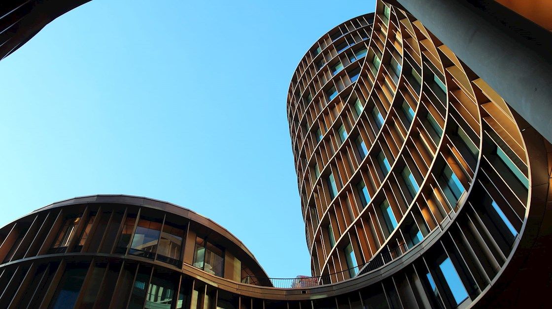 Architectural curved building against blue sky