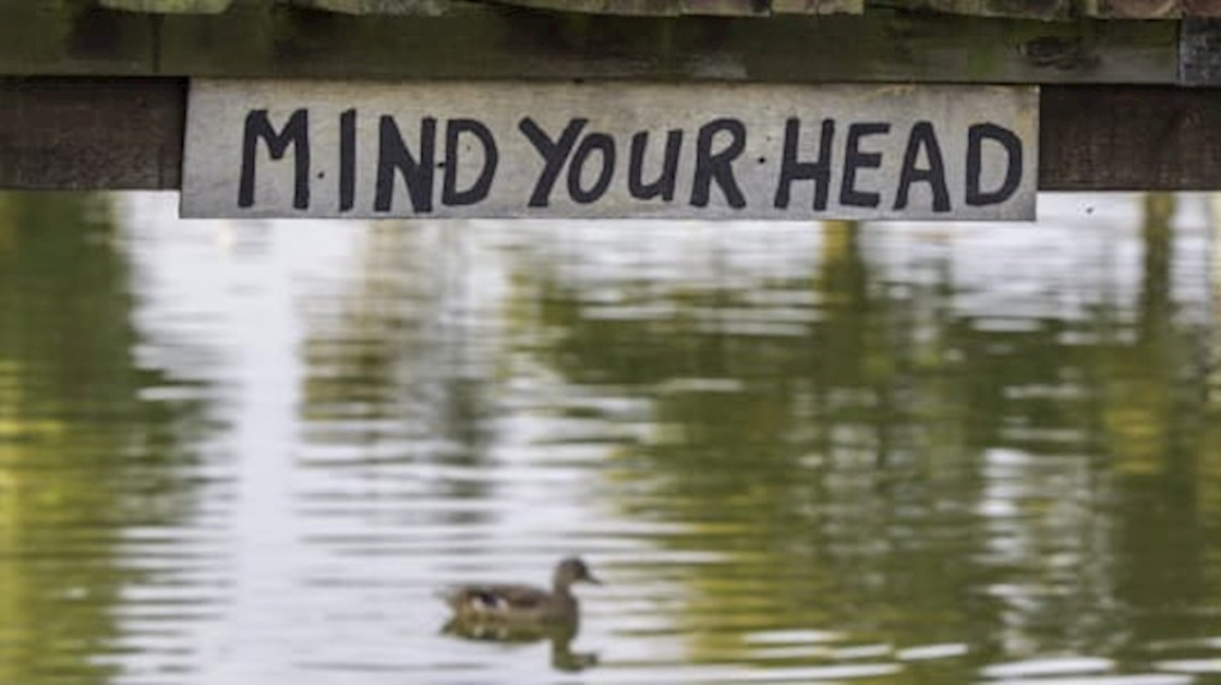 Low bridge with mind your head sign