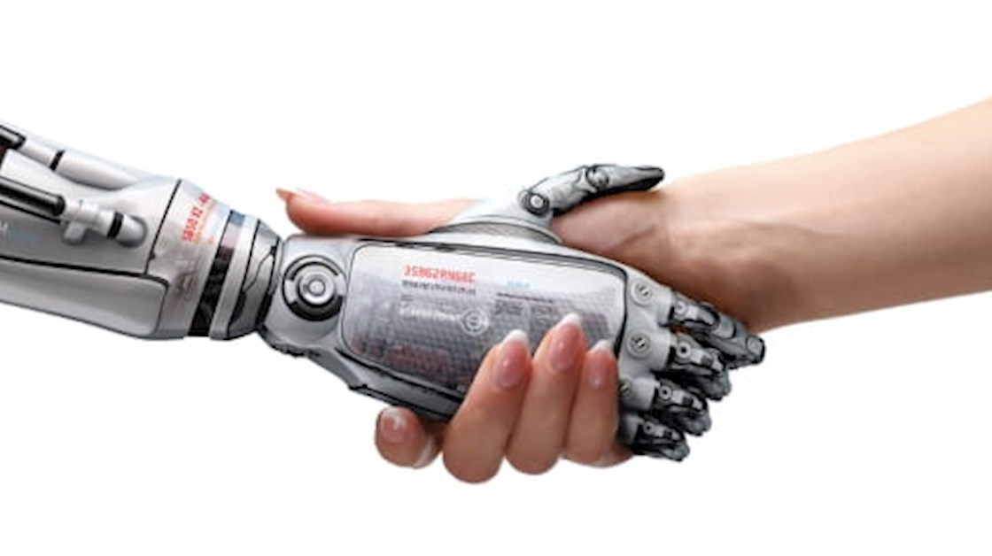 Robot arm shaking hands with human