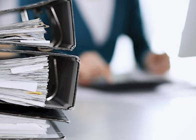 Person working at desk with paperwork