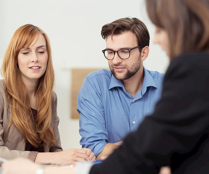 Young couple meeting with a solicitor