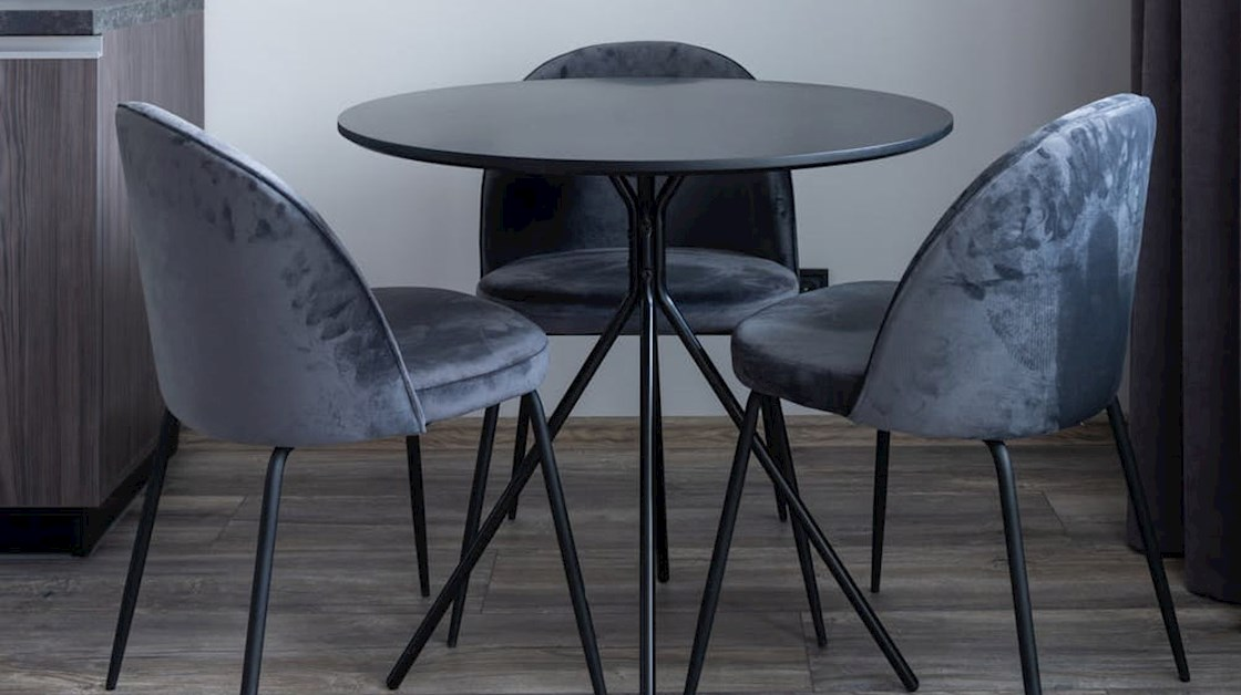 Three chairs around a table