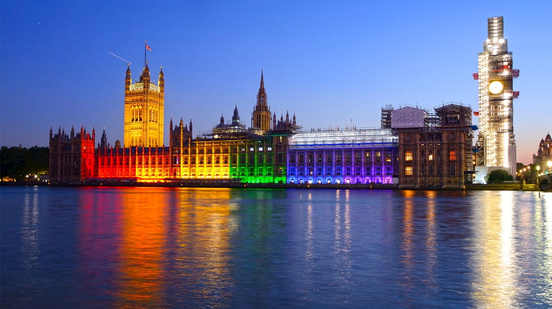 LGBT+ Pride flag illuminating the Palace of Westminster