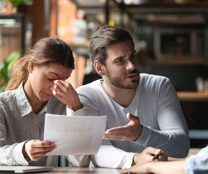 Angry young couple complaining, dissatisfied clients
